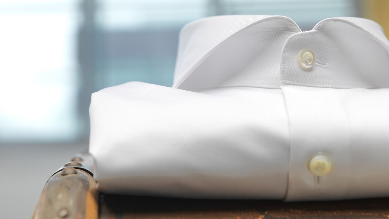 White shirt laying on a travelcase
